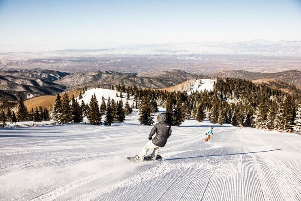 Photo -  Skiers are shown on the slopes at Ski Santa Fe. The longest run down the mountain is about three miles. [Photo provided]