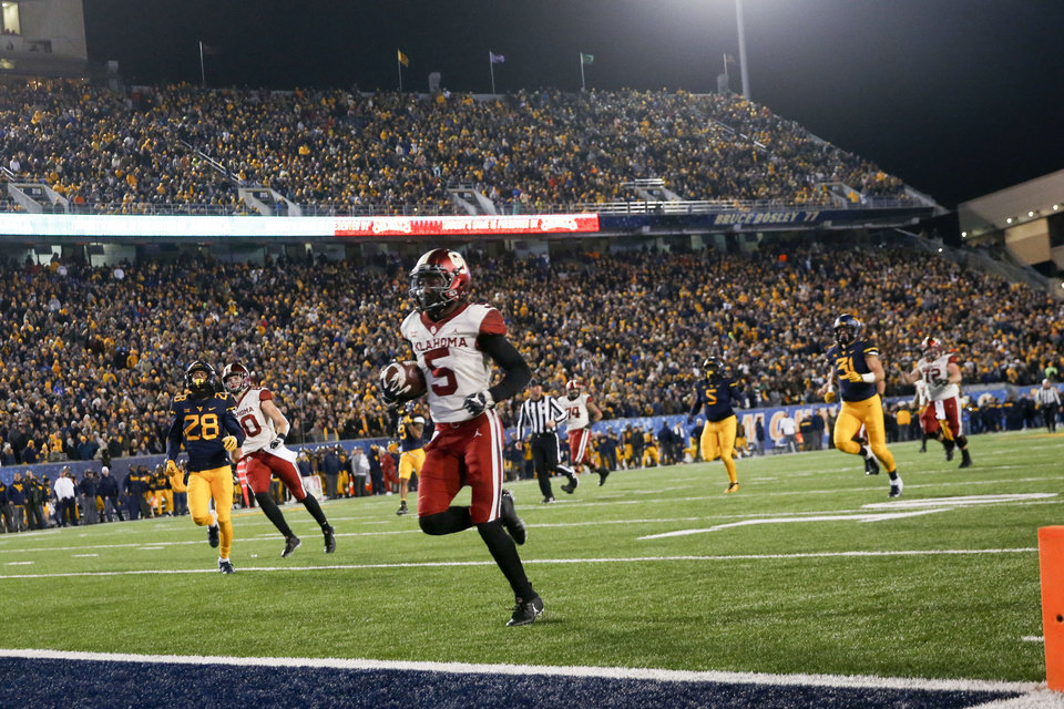 Photo - Oklahoma Sooners wide receiver Marquise Brown (5) scores a touchdown during the NCAA football game between the Oklahoma Sooners and the West Virginia Mountaineers at Mountaineer Field at Milan Puskar Stadium in Morgantown, W.Va on Friday, November 23, 2018. IAN MAULE/Tulsa World