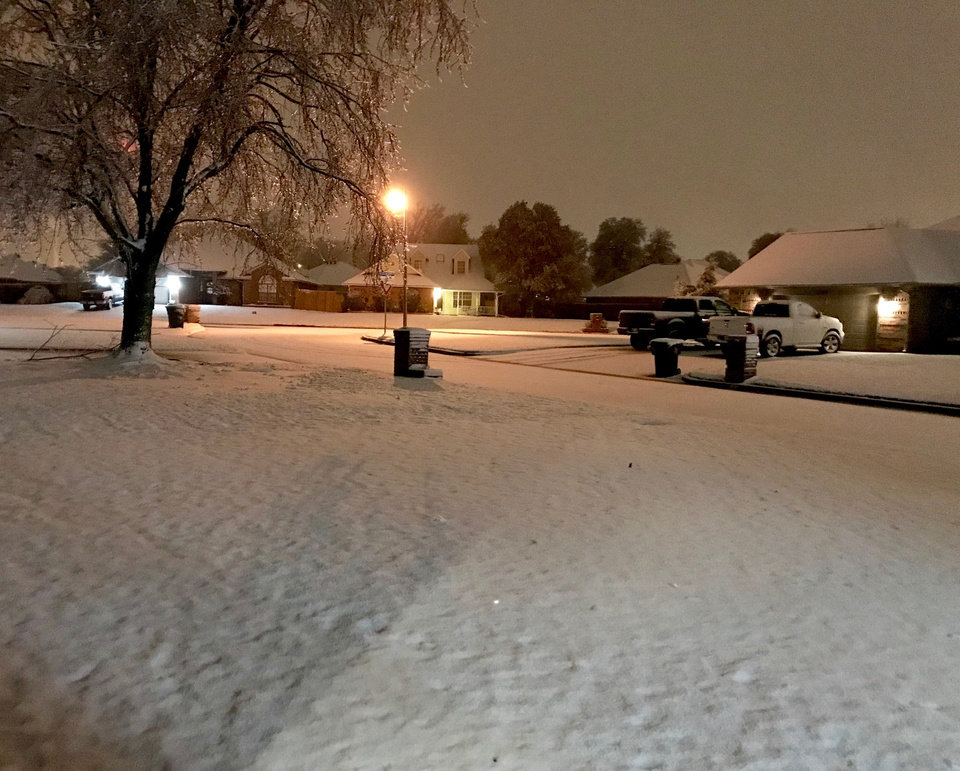 Photo - Snow blankets lawns in a Midwest neighborhood Thursday night, Jan.3, 2019.