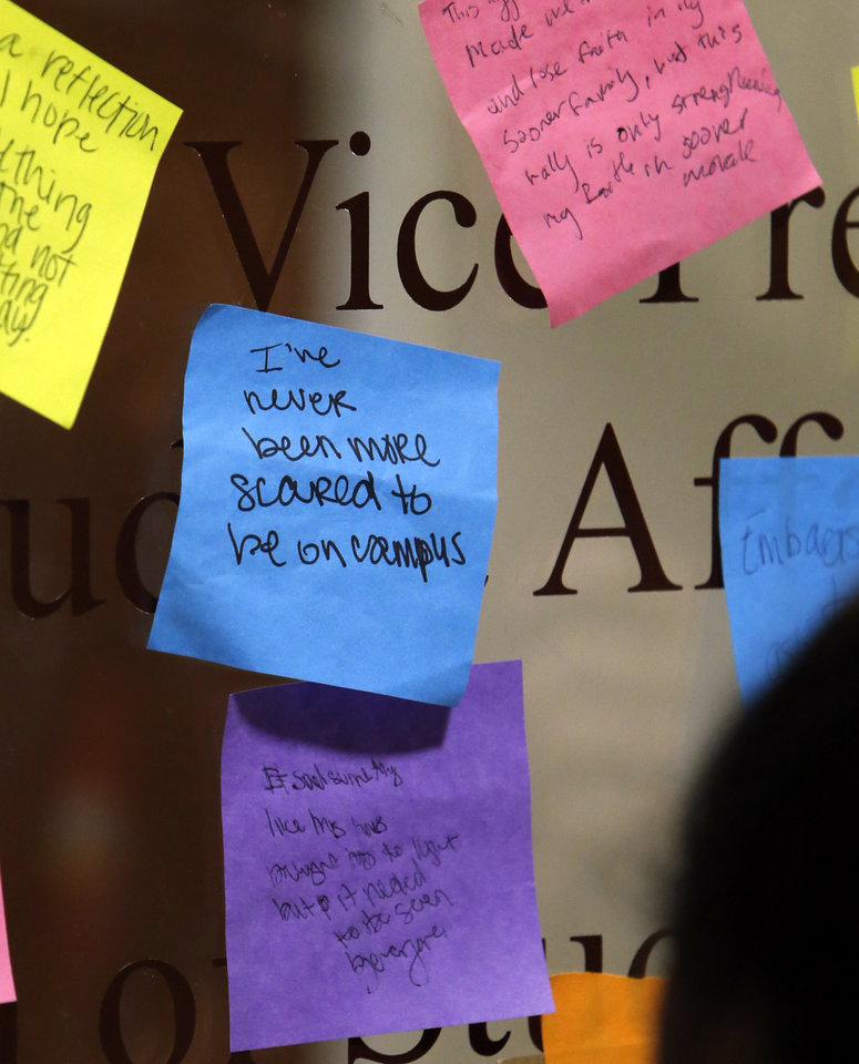 Photo - Students at the University of Oklahoma place notes on the door of the Office of Student Affairs as they protest a fraternity's  racist comments on March 9, 2015 in Norman, Okla. Photo by Steve Sisney, The Oklahoman