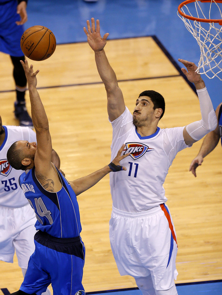 Photo - Oklahoma City's Enes Kanter (11) defends against Dallas' Devin Harris (34) during Game 5 of the first round series between the Oklahoma City Thunder and the Dallas Mavericks in the NBA playoffs at Chesapeake Energy Arena in Oklahoma City, Monday, April 25, 2016. Photo by Sarah Phipps, The Oklahoman