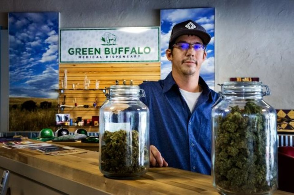 Photo -  Green Buffalo owner Joe Wilson poses for a photo at his dispensary located at 784 Asp Ave. in Norman on August 1.  Despite colleges around the state still banning even medical marijuana, Wilson thinks he has the best location in the state. [Chris Landsberger/The Oklahoman]