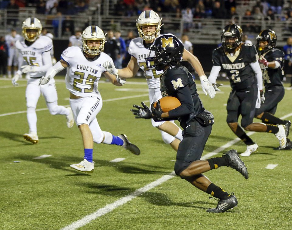 Photo - Midwest City's Brian Wilson Jr. (5) carries the ball on a long kick return in the second quarter during a high school football game between Midwest City and Choctaw at Rose Field in Midwest City, Okla., Friday, Nov. 1, 2019. [Nate Billings/The Oklahoman]