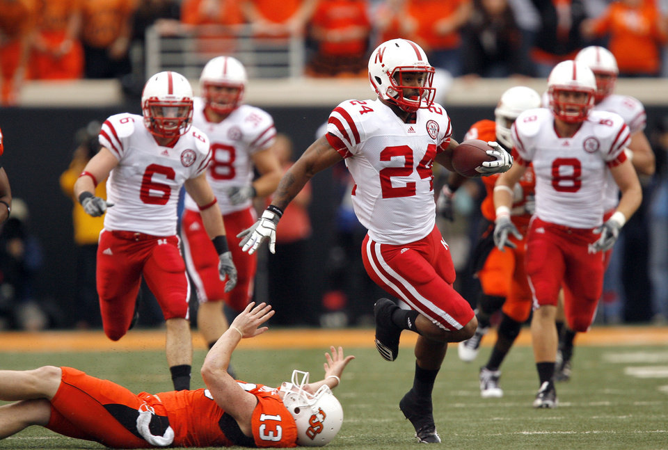 Photo - Nebraska's Niles Paul slips past OSU's Quinn Sharp as he returns a kickoff for touchdown during the college football game between the Oklahoma State Cowboys (OSU) and the Nebraska Huskers (NU) at Boone Pickens Stadium in Stillwater, Okla., Saturday, Oct. 23, 2010. Photo by Sarah Phipps, The Oklahoman