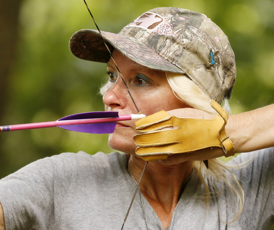Photo -  Lori Patterson of Piedmont takes aim with a traditional bow. [PHOTO BY NATE BILLINGS, THE OKLAHOMAN]