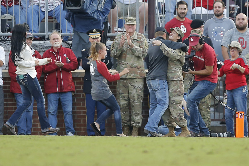 Photo - Oklahoma National Guard Sergeant Brandy Dill surprises her family following a video during a college football game between the University of Oklahoma Sooners (OU) and the Army Black Knights at Gaylord Family-Oklahoma Memorial Stadium in Norman, Okla., Saturday, Sept. 22, 2018. Photo by Bryan Terry, The Oklahoman