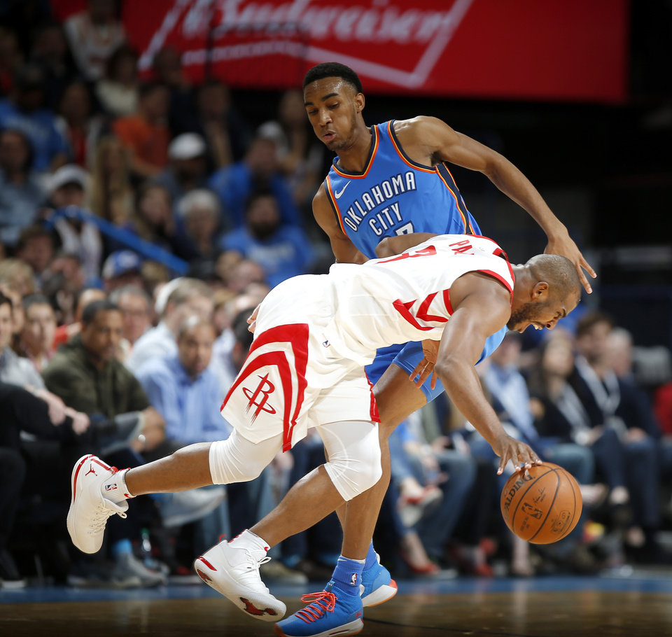 Photo - Oklahoma City's Terrance Ferguson (23) defends Houston's Chris Paul (3) during an NBA basketball game between the Oklahoma City Thunder and the Houston Rockets at Chesapeake Energy Arena in Oklahoma City, Tuesday, March 6, 2018.  Photo by Bryan Terry, The Oklahoman
