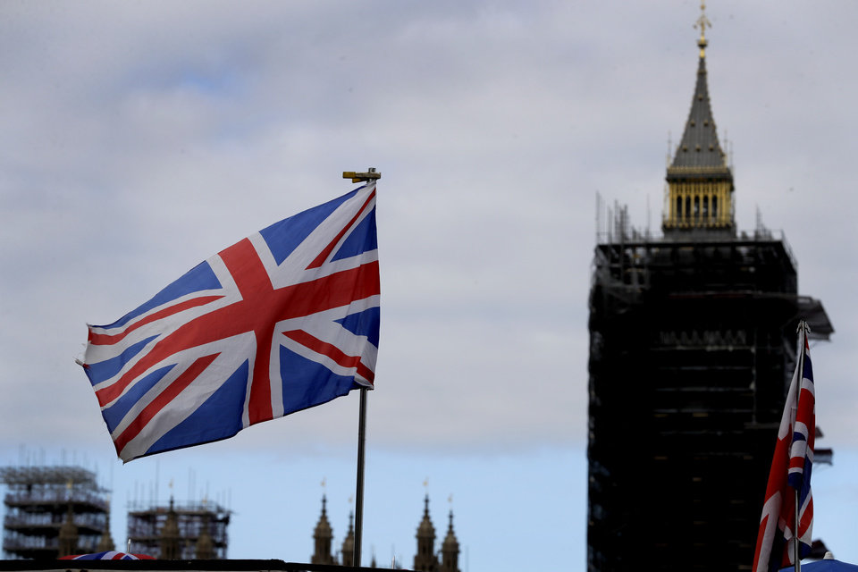 "Photo -  The Union flag flies above a souvenir stand in front of Big Ben in London, Friday, Oct. 16, 2020. Britain's foreign minister says there are only narrow differences remaining in trade talks between the U.K. and the European Union. But Dominic Raab insists the bloc must show more ""flexibility"" if it wants to make a deal. (AP Photo/Kirsty Wigglesworth)"