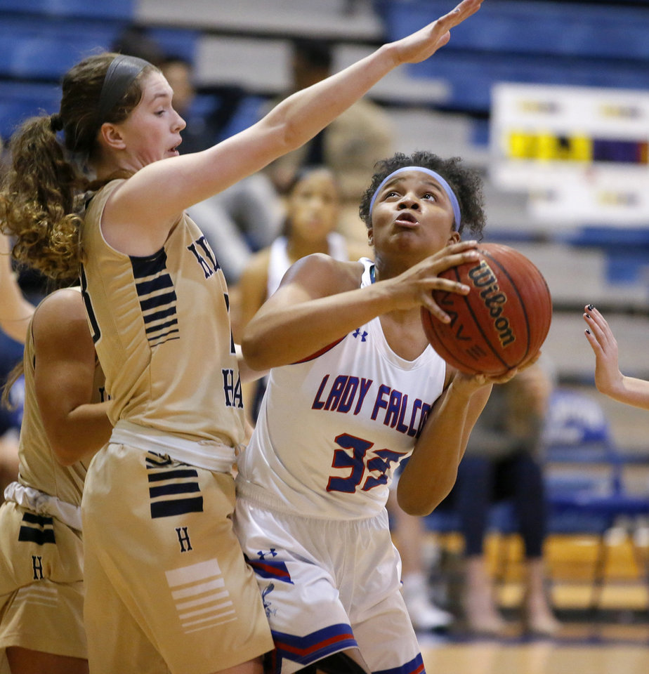 Photo - Millwood's Nykale Cramer puts up a shoot beside Heritage Hall's Avery Freeman  during a high school basketball game between Millwood and Heritage Hall at Millwood in Oklahoma City, Tuesday, Feb. 5, 2019. Photo by Bryan Terry, The Oklahoman