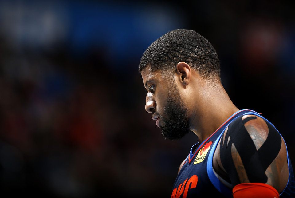 Photo - Oklahoma City's Paul George (13) reacts during the NBA basketball game between the Oklahoma City Thunder and the Golden State Warriors at Chesapeake Energy Arena,  Saturday, March 16, 2019. Photo by Sarah Phipps, The Oklahoman