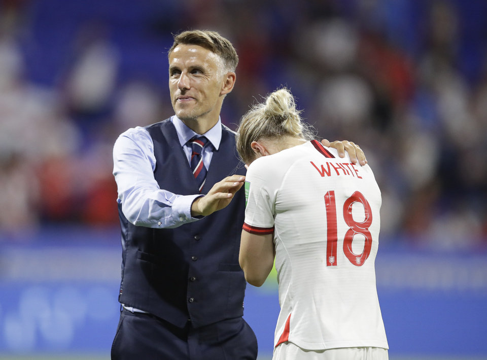 Photo - England head coach Philip Neville, left, comforts England's Ellen White after the Women's World Cup semifinal soccer match between England and the United States, at the Stade de Lyon, outside Lyon, France, Tuesday, July 2, 2019. (AP Photo/Alessandra Tarantino)