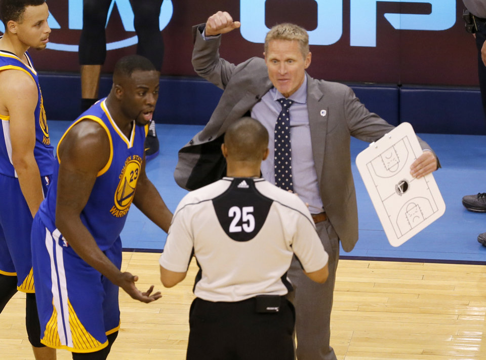 Photo - Golden State head coach Steve Kerr and Golden State 's Draymond Green (23) argue a foul during Game 3 of the Western Conference finals in the NBA playoffs between the Oklahoma City Thunder and the Golden State Warriors at Chesapeake Energy Arena in Oklahoma City, Sunday, May 22, 2016. Photo by Sarah Phipps, The Oklahoman