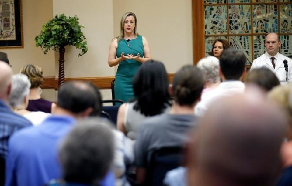 Photo -  U.S. Rep. Kendra Horn speaks during a town hall meeting on Saturday at St. Charles Borromeo Catholic Church in Warr Acres.  [Sarah Phipps/The Oklahoman]