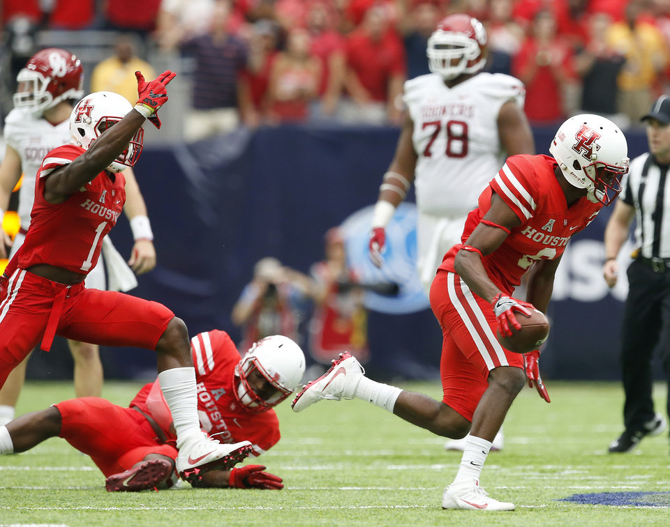 Photo - Houston's Howard Wilson (6) celebrates after reovering a fumble during the AdvoCare Texas Kickoff college football game between the University of Oklahoma Sooners (OU) and the Houston Cougars at NRG Stadium in Houston, Saturday, Sept. 3, 2016. Houston won 33-23. Photo by Bryan Terry, The Oklahoman