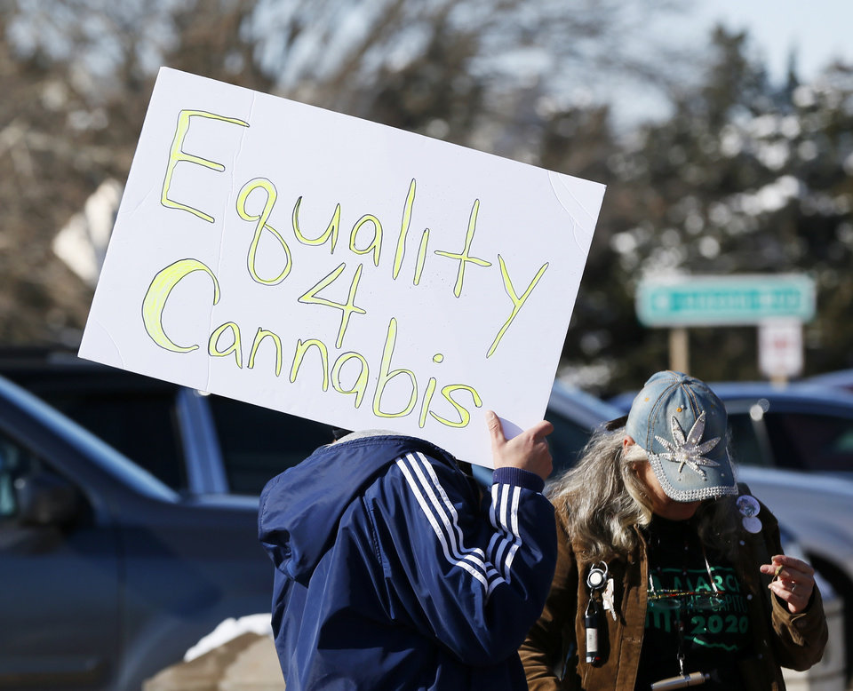 Photo - A rallygoer holds a sign during March the Capitol 2020 at the state Capitol in Oklahoma City, Thursday, Feb. 6, 2020. The rally was to protest many of the bills filed in the legislative session that would affect medical marijuana patients and businesses. [Nate Billings/The Oklahoman]