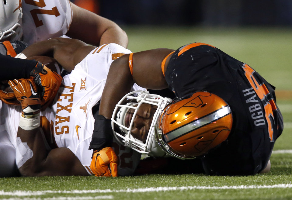 Photo - Oklahoma State's Emmanuel Ogbah (38) tackles Texas Johnathan Gray (32)  during the college football game between the Oklahoma State University Cowboys (OSU) the University of Texas Longhorns (UT) at Boone Pickens Staduim in Stillwater, Okla. on Saturday, Nov. 15, 2014.  Photo by Sarah Phipps, The Oklahoman