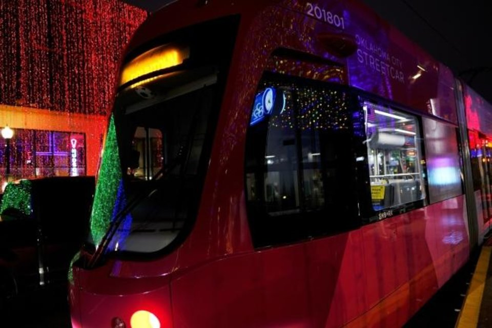 Photo -  The OKC Streetcar reflects Automobile Alley's holiday lights recently. [Doug Hoke/The Oklahoman Archives]