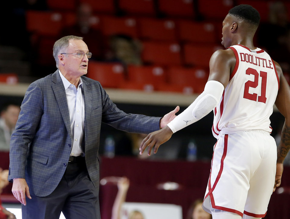 Photo - Oklahoma head coach Lon Kruger talks with Kristian Doolittle (21) during the college basketball game between Oklahoma Sooners and Southeastern Storm at the Lloyd Noble Center in Norman, Okla., Tuesday, Oct. 29, 2019. [Sarah Phipps/The Oklahoman]