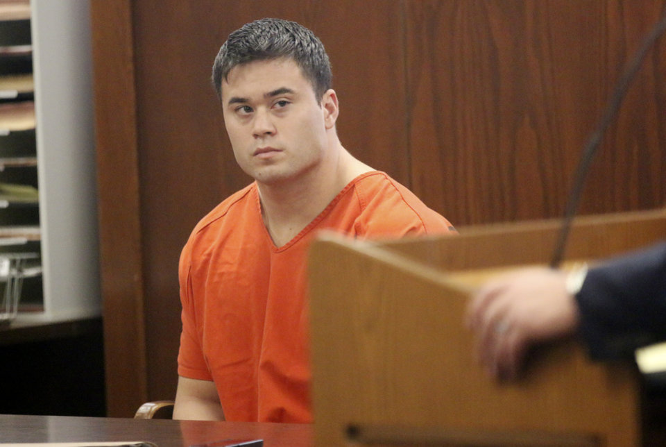 Photo -                                        Right:  Daniel Ken Holtzclaw appears for a hearing Wednesday in the Oklahoma County Courthouse.                     PHOTO BY STEVE GOOCH, THE OKLAHOMAN
