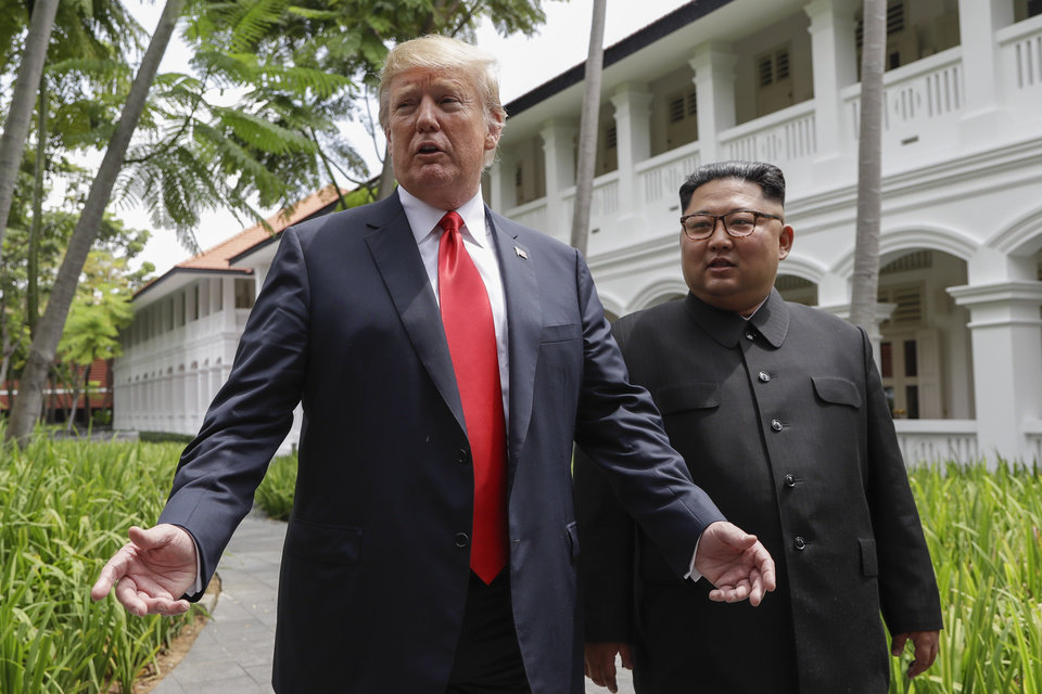 Photo -  In this June 12 photo, President Donald Trump and North Korea leader Kim Jong Un stop to talk with the media as they walk from their lunch at the Capella resort on Sentosa Island in Singapore. [Associated Press File Photo]
