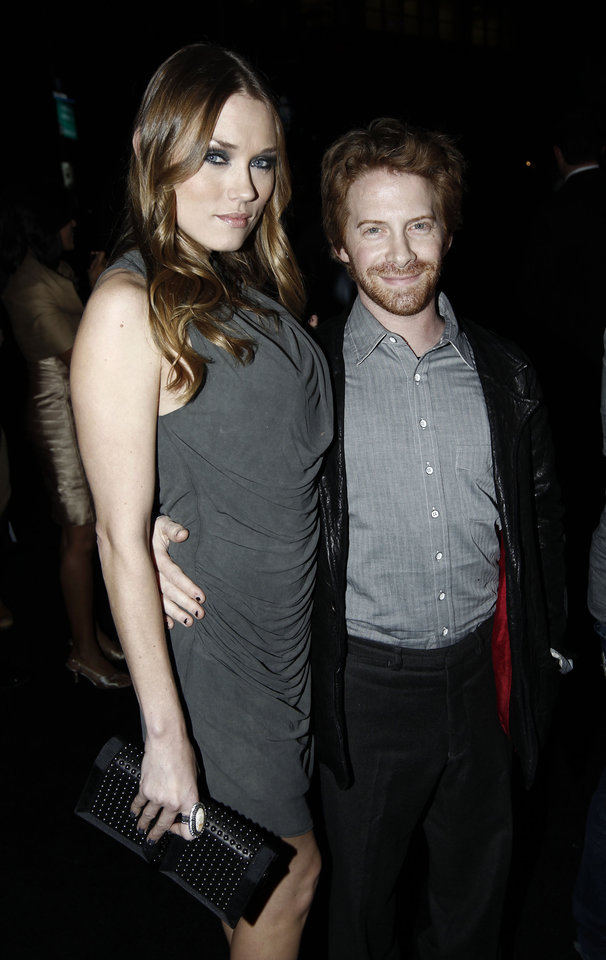 Photo - Seth Green, right, and Clare Grant arrive at the world premiere of