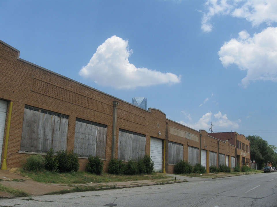 Photo - The former home of the Oklahoma Operating Co. is among a collection of buildings near Classen and the new boulevard route that promoters say could be the next Film Row or Automobile Alley - if the boulevard is built at street level instead of being elevated as planned.  Steve Lackmeyer