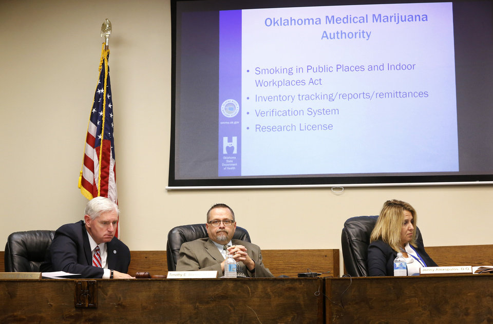 Photo - From left are Tom Bates. interim chairman for the Oklahoma Department of Health; Timothy Starkey, board president and Dr. Jenny Alexopulos. The Oklahoma State Department of Health voted at their monthly meeting Tuesday morning, July 10, 2018, to ban sales of smokeable forms of medical marijuana and to require dispensaries to hire a pharmacist. The Board of Health voted on 75 pages of rules creating a rough framework for patients, physicians, caretakers and business owners interested in medical marijuana. The ban on sales of leaves and flowers for smoking and the requirement to hire a pharmacist weren't in the draft rules presented to the board, but were a priority of a coalition of medical groups. Julie Ezell, the Health Department's general counsel, presented the rules to a packed board room and to members of the public watching in an overflow room and online. She cautioned board members that the two new rules they added might not be allowed under the state question, inviting a court challenge. Photo by Jim Beckel, The Oklahoman