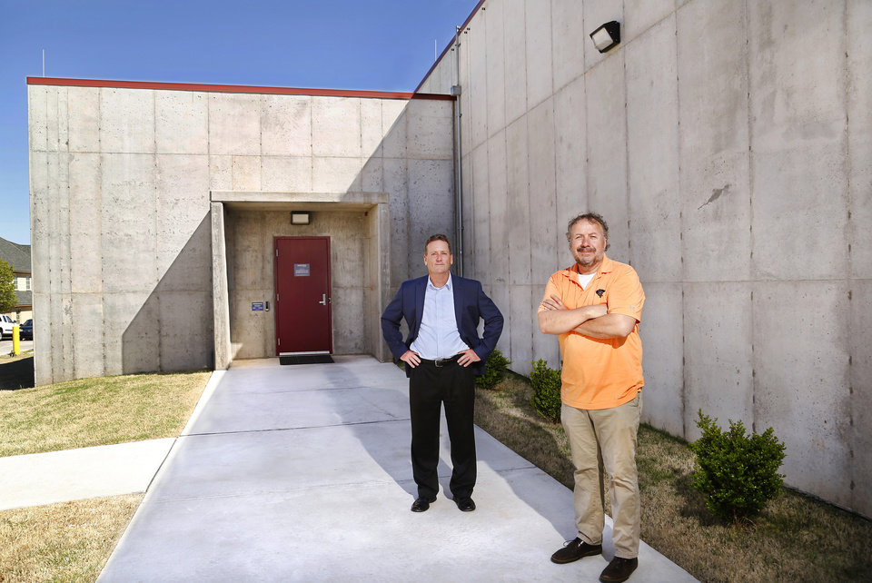 Photo -  Greg Blakely, left, business development, and  Kurt Kraft, president, outside the bunker.  Located in the metro area, this bunker operated by MIDCON Data stores client servers in a secure, tornado and earthquake-proof concrete-fortified facility. The building was designed with redundancies for power, communications and HVAC.  [JIM BECKEL/THE OKLAHOMAN]