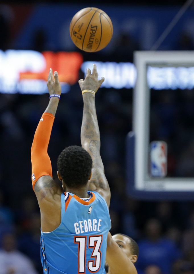 Photo - Oklahoma City's Paul George (13) shoots during the NBA game between the Oklahoma City Thunder and the Orlando Magic at the Chesapeake Energy Arena  Tuesday, Feb. 5, 2019. Photo by Sarah Phipps, The Oklahoman