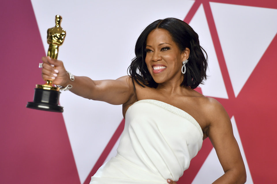 Photo -  Regina King poses with the award for best performance by an actress in a supporting role for