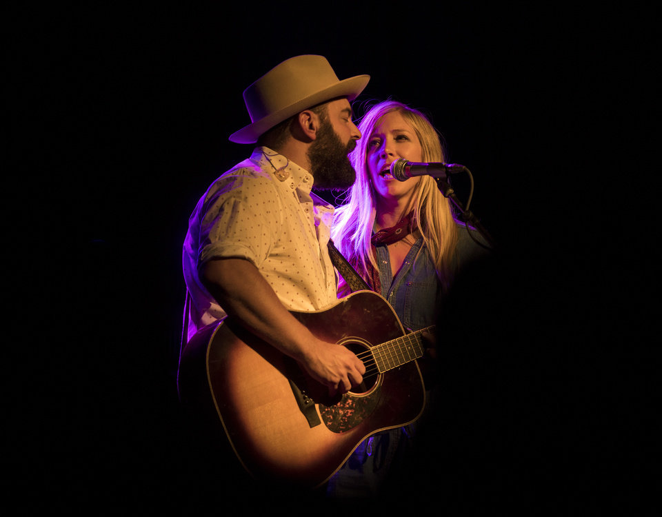 Photo - Drew Holcomb and Ellie Holcomb sing a duet at The Jones Assembly. Drew Holcomb and The Neighbors opened the Willie Nelson concert. [Photo by Nathan Poppe, The Oklahoman]