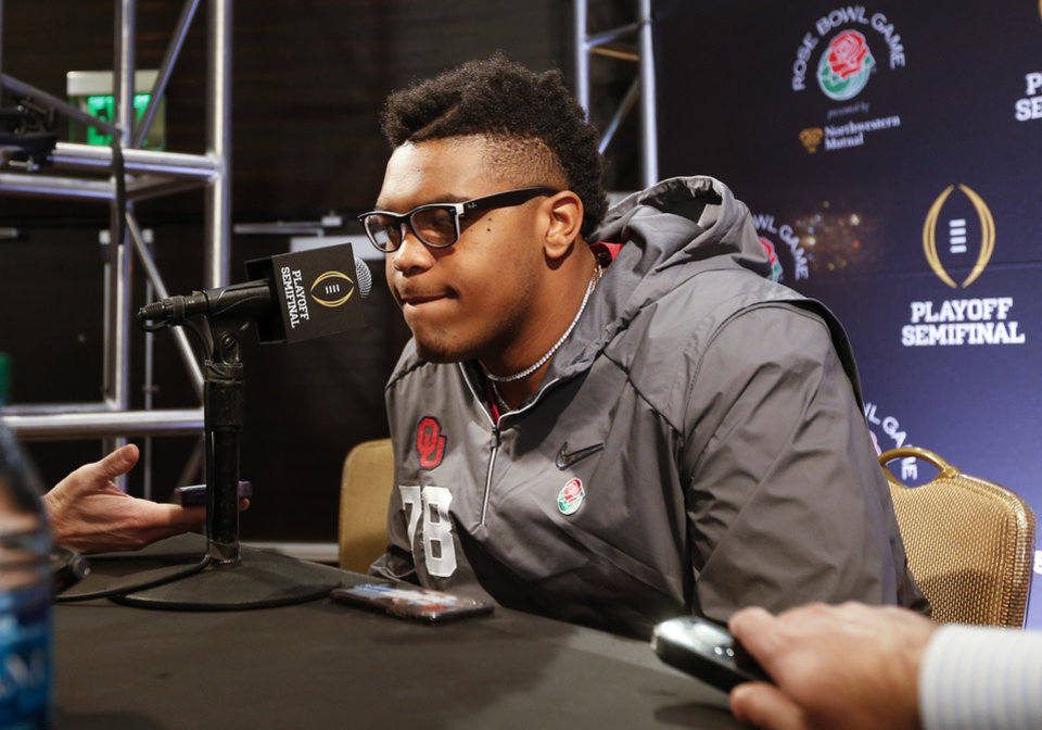 Photo - Oklahoma's Orlando Brown (78) listens to a question during media day for the Oklahoma Sooners at the L.A. Hotel Downtown in Los Angeles, Saturday, Dec. 30, 2017. OU will play Georgia in the Rose Bowl Game, a College Football Playoff Semifinal, on Jan. 1, 2018. Photo by Nate Billings, The Oklahoman
