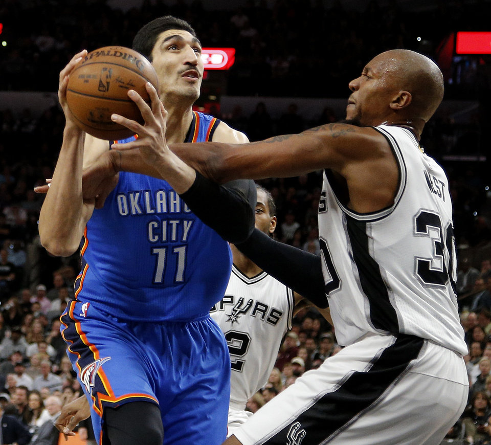 Photo - Oklahoma City's Enes Kanter (11) is fouled by San Antonio's David West (30) during Game 2 of the second-round series between the Oklahoma City Thunder and the San Antonio Spurs in the NBA playoffs at the AT&T Center in San Antonio, Monday, May 2, 2016. Photo by Bryan Terry, The Oklahoman