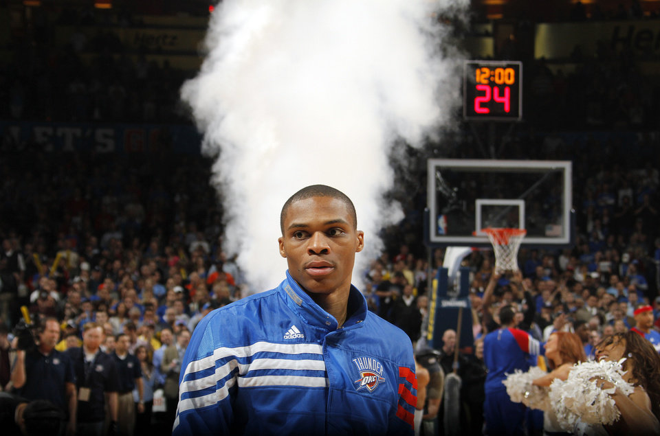 Photo - Oklahoma City Thunder point guard Russell Westbrook (0) looks on during pre game during the NBA basketball game between the Oklahoma City Thunder and the Los Angeles Clippers at Chesapeake Energy Arena on Wednesday, March 21, 2012 in Oklahoma City, Okla.  Photo by Chris Landsberger, The Oklahoman