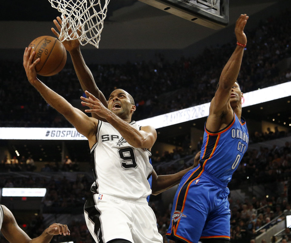 Photo - San Antonio's Tony Parker (9) goes past Oklahoma City's Russell Westbrook (0) during Game 5 of the second-round series between the Oklahoma City Thunder and the San Antonio Spurs in the NBA playoffs at the AT&T Center in San Antonio, Tuesday, May 10, 2016. Oklahoma City won 95-91. Photo by Bryan Terry, The Oklahoman