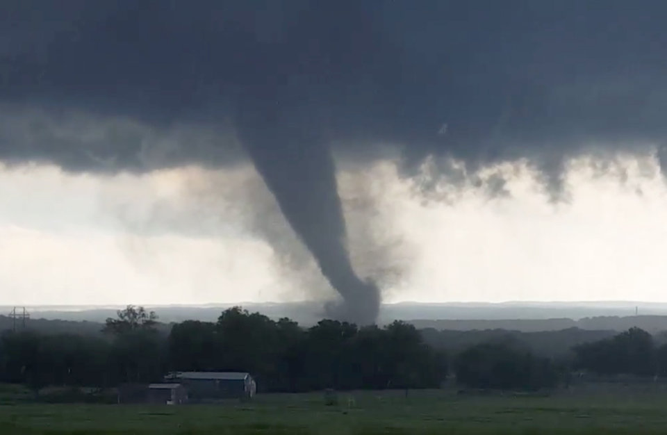 "Photo - This image made from a video taken through a car window shows a tornado near Wynnewood, Okla., Monday, May 9, 2016. A broad tornado capable of leaving ""catastrophic"" damage in its wake churned across the Oklahoma landscape Monday, prompting forecasters to declare a tornado emergency for two communities directly in its path. (Hayden Mahan via AP) MANDATORY CREDIT"