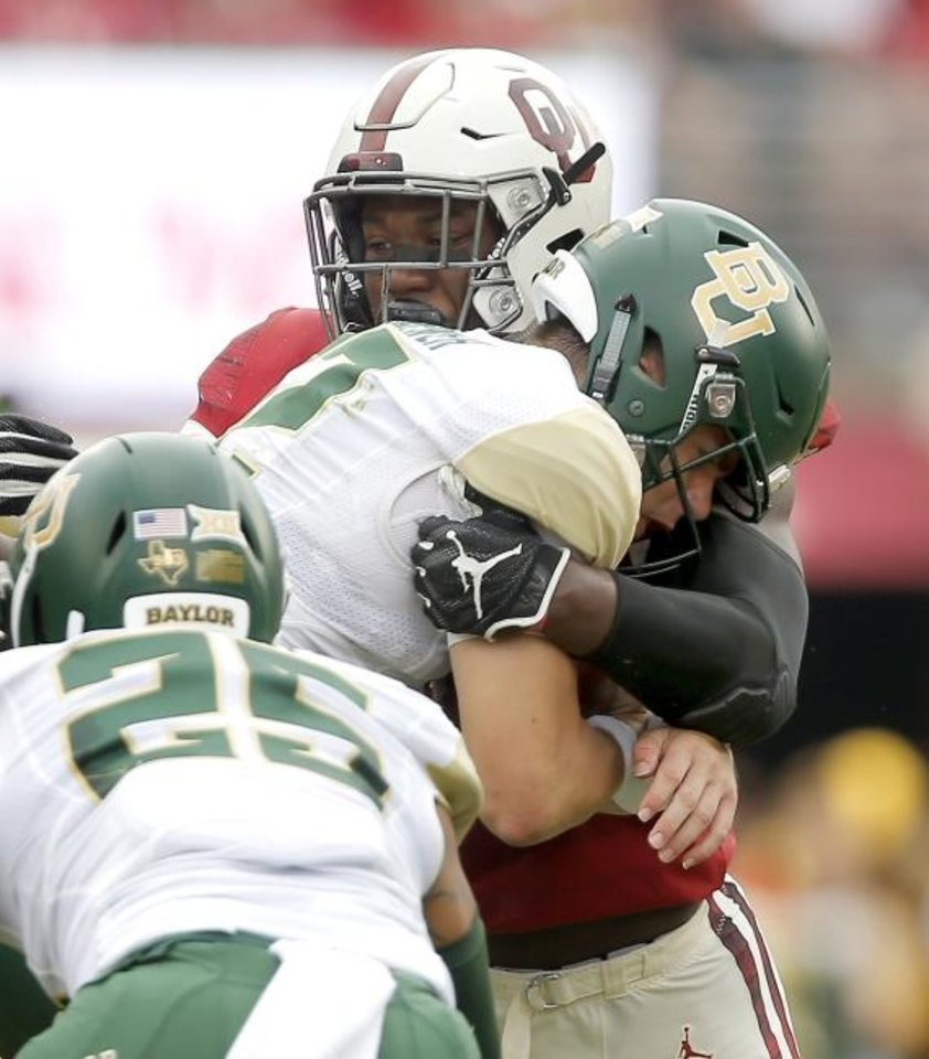 Photo -  Oklahoma's Kenneth Murray sacks Baylor's Charlie Brewer during the Sooners' win in Norman in 2018. No. 10-ranked OU will head to Waco, Texas, to take on No. 13 Baylor this Saturday. [Bryan Terry/The Oklahoman]