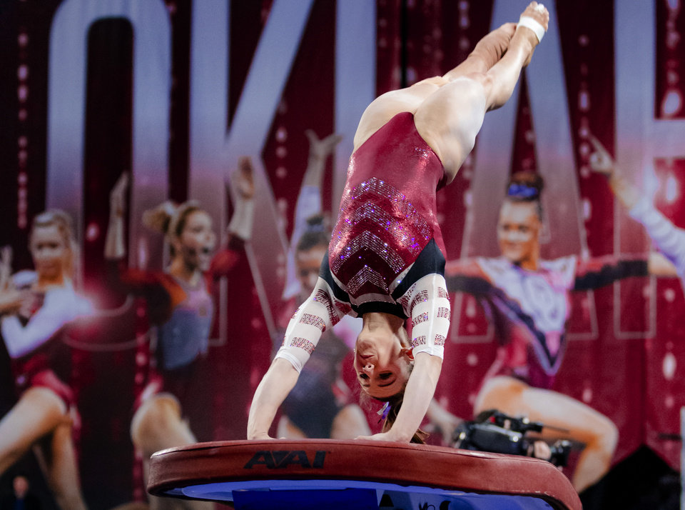 Photo - University of Oklahoma's Anastasia Webb competes in the vault during the women's gymnastics competition between the University of Oklahoma and Arkansas at the Lloyd Noble Center in Norman, Okla Monday, Jan. 20, 2020.   [Chris Landsberger/The Oklahoman]