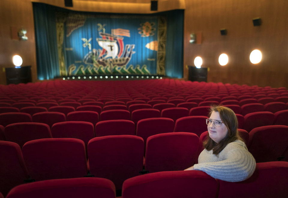 Photo -  Malin Hellberg, sits alone to watch the film Tigrar, in Gothenburg, Sweden on Saturday, Jan. 30, 2021. The 44th Goteborg film festival opened this weekend in a mostly virtual format. For the real world movie experience, a lottery determines who gets the one ticket for the 700-seat cinema. (AP Photo/Thomas Johansson)