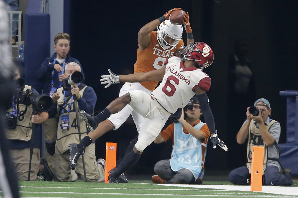 Photo - Collin Johnson (9) of Texas catches a touchdown pass behind Oklahoma's Tre Brown (6) during the Big 12 Championship football game between the Oklahoma Sooners (OU) and the Texas Longhorns (UT) at AT&T Stadium in Arlington, Texas, Saturday, Dec. 1, 2018.  Oklahoma won 39-27. Photo by Bryan Terry, The Oklahoman