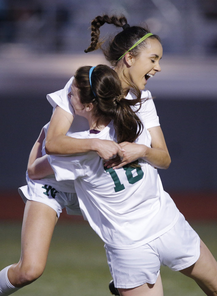 Photo - NN #6 Normandie Junglen celebrates with #18 Jenna Miller after she scored Norman North's second goal in the second half during the 6A girls state soccer championship between Norman North Timberwolves and Mustang Bronchos at Taft Stadium in Oklahoma City, Saturday, May 11, 2019.  [Doug Hoke/The Oklahoman]