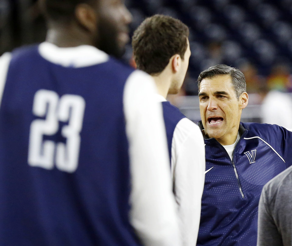 Photo - Villanova coach Jay Wright talks to his team during practice on Final Four Friday before the national semifinal between the Oklahoma Sooners and the Villanova Wildcats in the NCAA Men's Basketball Championship at NRG Stadium in Houston, Friday, April 1, 2016. OU will play Villanova in the Final Four on Saturday. Photo by Nate Billings, The Oklahoman
