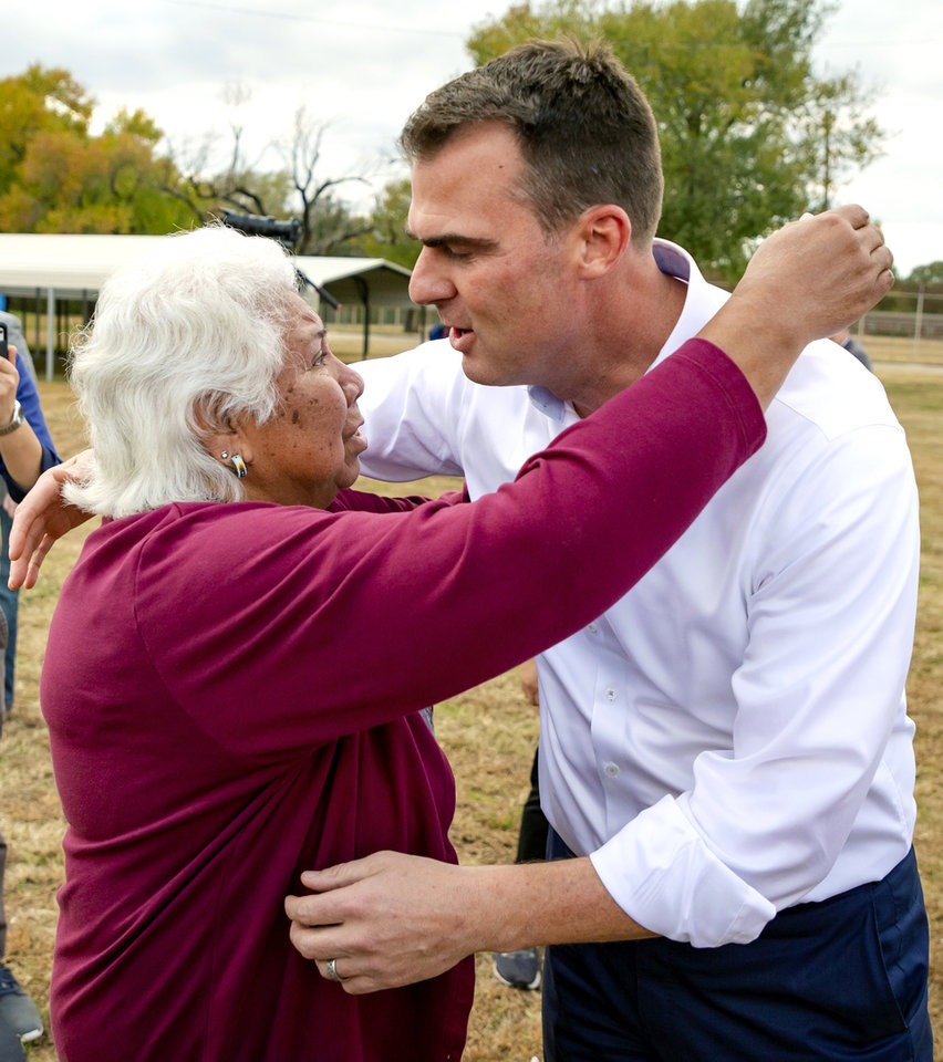 Photo - Sally Taylor hugs Gov. Kevin Stitt thanking him for his help to have Taylor's granddaughter Tess Harjo released from the Dr. Eddie Warrior Correctional Facility on Monday, Nov. 4, 2019 in Taft, Okla. Governor Kevin Stitt greeted an estimated 70 women whose sentences he commuted from the facility. [Chris Landsberger/The Oklahoman]