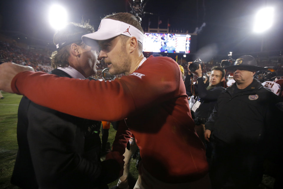 Photo - Oklahoma coach Lincoln Riley, right, and Oklahoma State coach Mike Gundy talk after a Bedlam college football game between the University of Oklahoma Sooners (OU) and the Oklahoma State University Cowboys (OSU) at Gaylord Family-Oklahoma Memorial Stadium in Norman, Okla., Nov. 10, 2018.  Photo by Bryan Terry, The Oklahoman