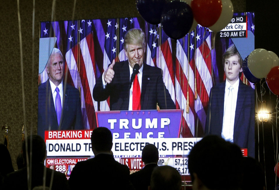 Photo - Guests watch a television broadcast of President-elect Donald Trump as he gives his acceptance speech, during an election night event organized by the U.S. Embassy in Skopje, Macedonia, Wednesday, Nov. 9, 2016. Trump defeated Hillary Clinton to be elected the 45th president of the United States. (AP Photo/Boris Grdanoski)