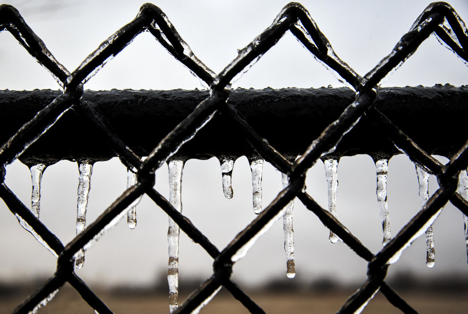 Photo - Ice forms on a fence as a winter storm makes its way through Oklahoma City, Okla. on Thursday, Jan. 3, 2019. Photo by Chris Landsberger, The Oklahoman
