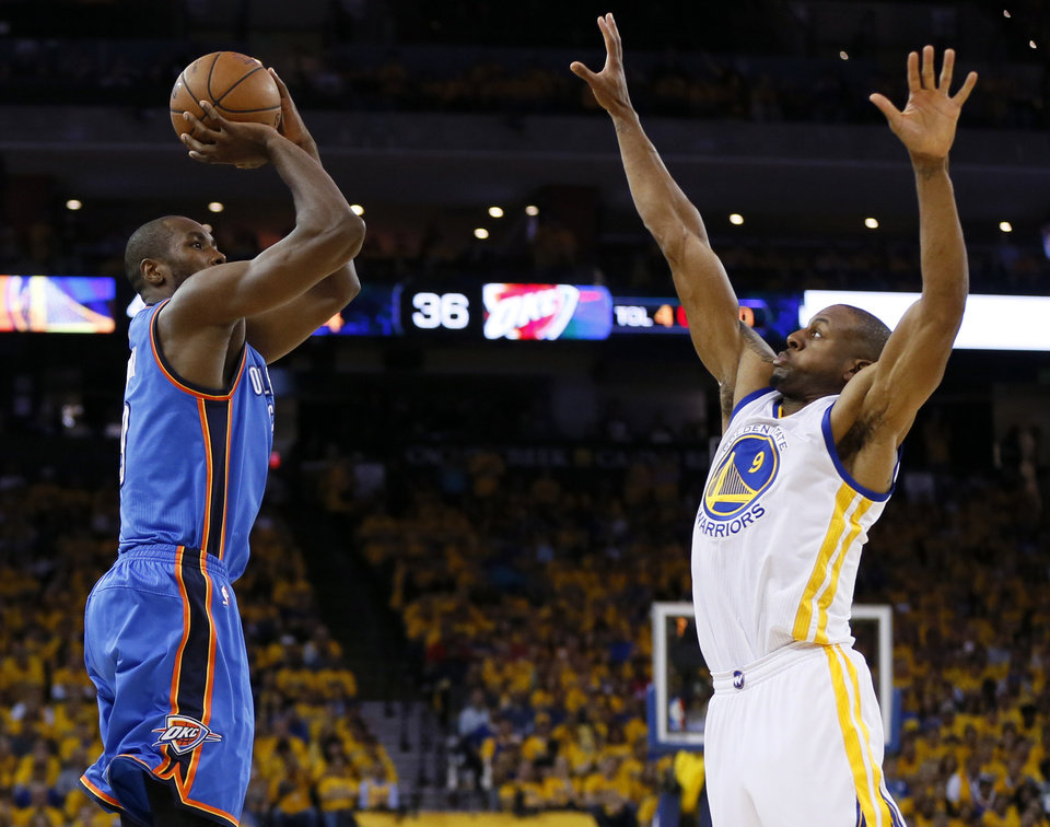 Photo - Oklahoma City's Serge Ibaka (9) shoots over Golden State's Andre Iguodala (9) during Game 2 of the Western Conference finals in the NBA playoffs between the Oklahoma City Thunder and the Golden State Warriors at Oracle Arena in Oakland, Calif., Wednesday, May 18, 2016. Photo by Nate Billings, The Oklahoman