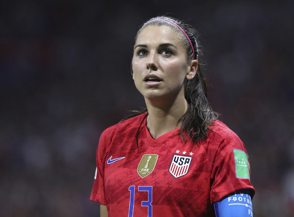 Photo - United States' Alex Morgan during the Women's World Cup semifinal soccer match between England and the United States, at the Stade de Lyon outside Lyon, France, Tuesday, July 2, 2019. (AP Photo/Laurent Cipriani)
