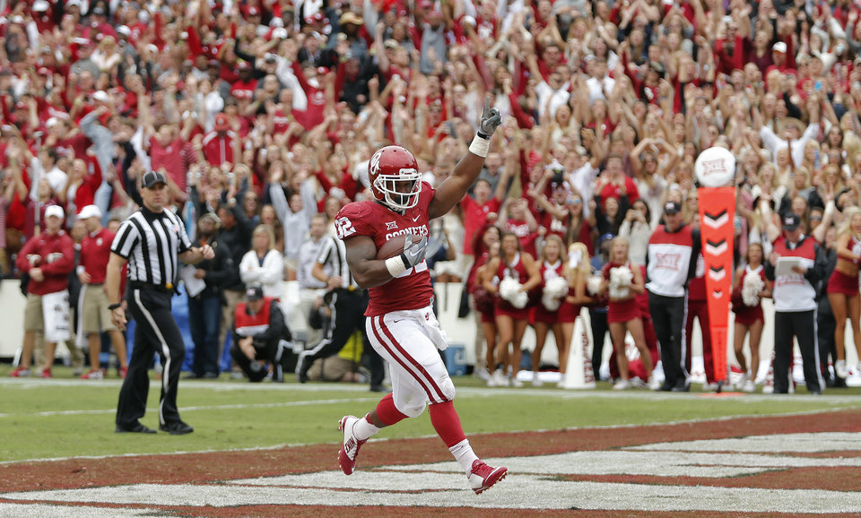 Photo - Oklahoma's Samaje Perine (32) reacts as he scores a touchdown during the college football game between the University of Oklahoma Sooners (OU) and the University of Texas Longhorns (UT) during the Red River Showdown at the Cotton bowl in Dallas, Texas on Saturday, Oct. 11, 2014. Photo by Chris Landsberger, The Oklahoman
