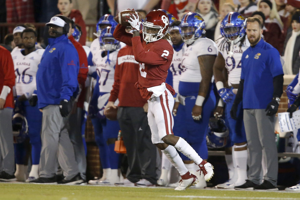 Photo - Oklahoma's CeeDee Lamb (2) catches a pass during a college football game between the University of Oklahoma Sooners (OU) and the Kansas Jayhawks (KU) at Gaylord Family-Oklahoma Memorial Stadium in Norman, Okla., Saturday, Nov. 17, 2018. Photo by Bryan Terry, The Oklahoman
